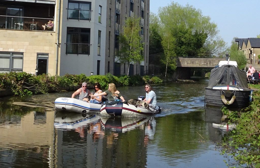 Canal neds sharing wine from boat to boat