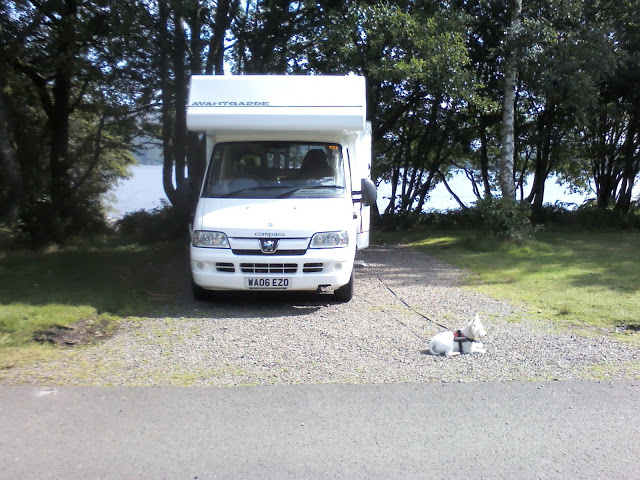 poppy the westie beside motorhome at Luss Loch Lomond